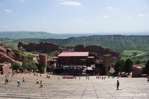 During the warmer months of summer you can find people working out at Red Rocks Amphitheatre by day, and tailgating concert goers by night. If you pay attention, you may also find the ghost of a miner who haunts the backstage areas of the stadium. Photo by Kailyn Lamb.